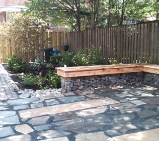 Paving Stone Contrasts With Wooden Benches and Brick Pathways
